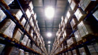 WS TD T/L Shot of large stacks of goods stored on warehouse shelves / LeBec, California, United States