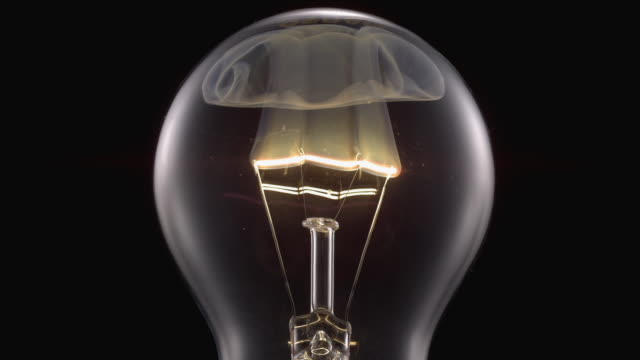 ECU SLO MO Shot of light bulb, showing burning and smoking tungsten wire / Munich, Bavaria, Germany