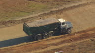 CU AERIAL TS Shot of loaded truck moving at Landfill (outside Fairmont Mill) / South Carolina, United States