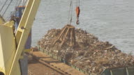 CU AERIAL TS Shot of loading ship with scrap metal at port / New Jersey, United States