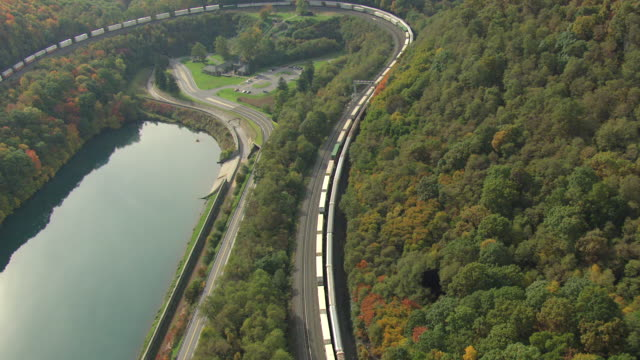 MS AERIAL TD TS Shot of long train snakes along Horseshoe Curve / Pennsylvania, United States