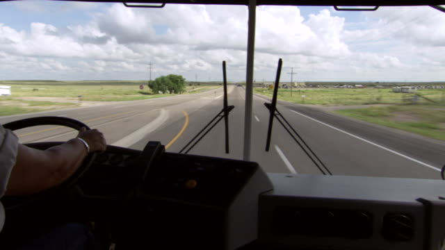 MS POV Shot of looking out from windshield as bus drives down highway / Roswell, New Mexico, United States