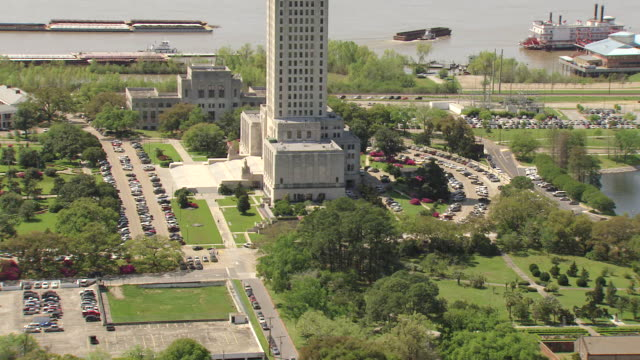 MS AERIAL TU Shot of louisiana state capitol building with Mississippi river / Baton Rouge, Louisiana, United States