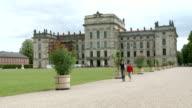 WS Shot of Ludwigslust Castle and people walking / Ludwigslust, Mecklenburg Vorpommern, Germany