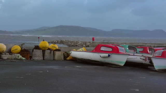 MS PAN SLO MO Shot of Lyme Regis and Jurassic coast with boats and buoys / Newcastle Emlyn, Ceredigion, United Kingdom
