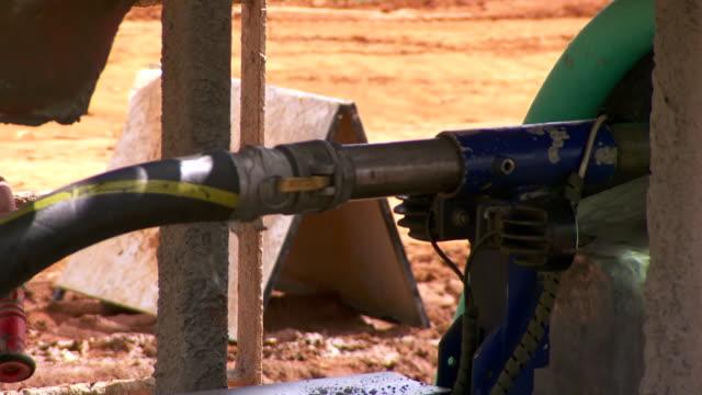 ECU TD Shot of Machine exiting pipe / Coolgardie and Kalgoorlie, Western Australia, Australia