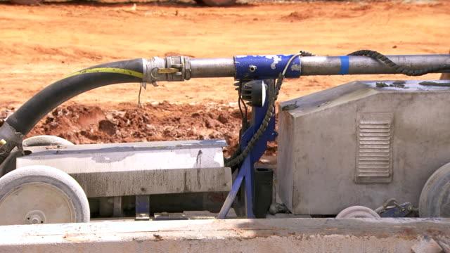 ECU TS Shot of Machine exiting pipe / Coolgardie and Kalgoorlie, Western Australia, Australia