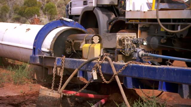 MS Shot of Machine watering pipe / Coolgardie and Kalgoorlie, Western Australia, Australia
