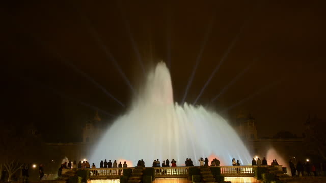 WS Shot of Magic Fountain with people in Barcelona illuminated at night / Barcelona, Catalunya, Spain
