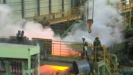 MS ZO Shot of making process steel, molten steel bar at end of production / Gwangyang, Jeollanamdo, South Korea