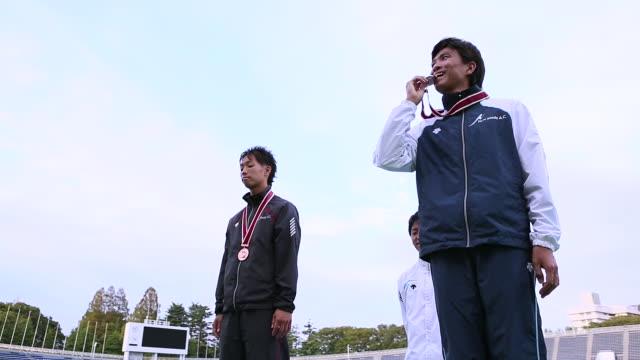 MS LA Shot of Male athlete receiving medal / Tokyo, Japan