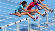 MS HA Shot of Male runners jumping hurdles in race / Tokyo, Japan