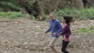 MS TS Shot of man and woman jogging in park / Los Angeles, California, United States
