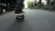 MS TS Shot of man cruising on skateboard / Taito ku, Tokyo, Japan