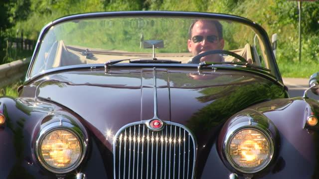 CU POV Shot of man driving with oldtimer through landscape / Saarburg, Rhineland Palatinate, Germany