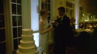 MS Shot of Man feeding woman cake at wedding reception / New York, United States