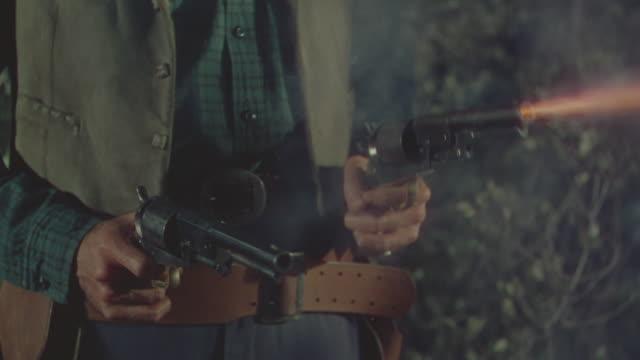 CU Shot of man hands firing guns