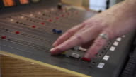 CU R/F Shot of man hands on playing with controls of sound mixer / Dublin, Georgia, United States