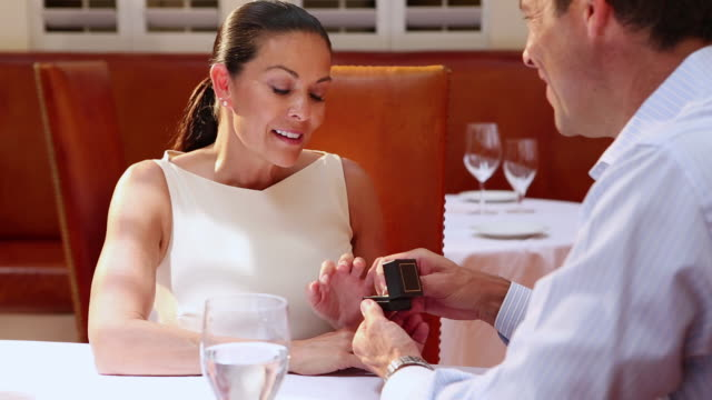 MS TU Shot of man proposing to his date in restaurant / Santa Fe, New Mexico, United States