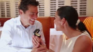 MS TU Shot of man proposing to women on his date in restaurant / Santa Fe, New Mexico, United States