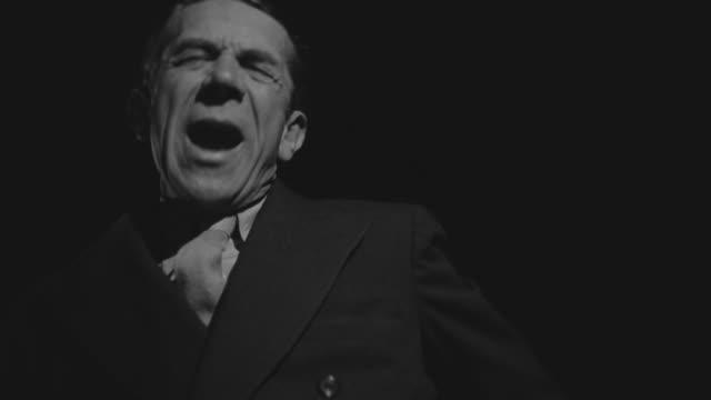 MS Shot of man talking in black background