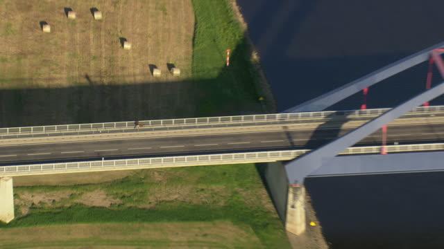 MS AERIAL ZO Shot of man walking at new bridge on Elbe river / Germany