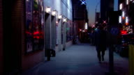 MS Shot of Man walking down sidewalk / New York, United States