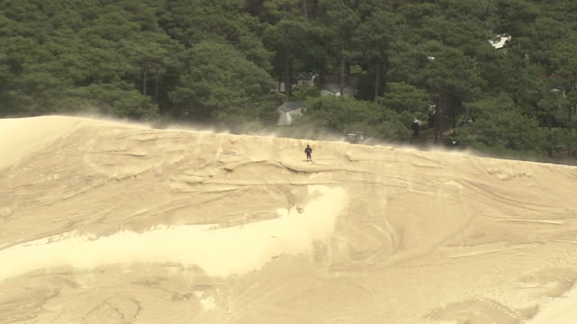 MS AERIAL ZO Shot of man walking on Dune du Pilat / Aquitaine, France