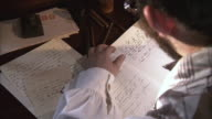 CU ZI shot of Man writing in his diary / Middleburg, Virginia, United States