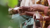MS Shot of Many hands spinning yarn / Soe, Mt. Mutis, West Timor Indonesia