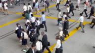 MS Shot of Many people exiting train station in morning in Shinagawa / Tokyo, Japan
