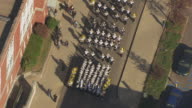 WS ZI AERIAL Shot of marching band in street at Ohio University Homecoming Parade / Athens, Ohio, United States