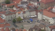 MS AERIAL Shot of market square with waterworks at Wismar / Germany