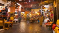 MS T/L Shot of Marrakesh market 'souq as Smarrine' with people moving / Marrakech, Morocco