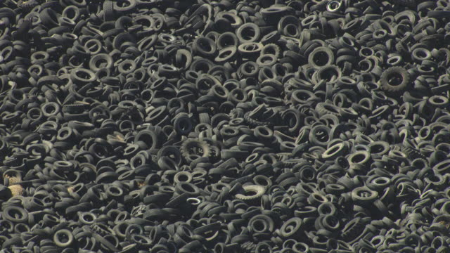 CU ZO AERIAL Shot of massive field of discarded tires at tire dump in el paso country / Colorado, United States