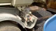 CU Shot of material unloading to asphalt laying machine / Saarburg, Rhineland-Palatinate, Germany