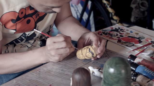 CU PAN Shot of Matryoshka doll artist working in the room / Nerima, Tokyo, Japan