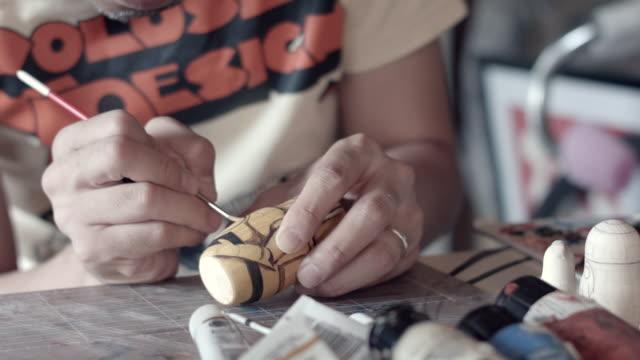 CU Shot of Matryoshka doll artist working in the room / Nerima, Tokyo, Japan