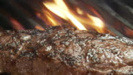 CU ZO Shot of  Meat  grilling steaks with flame and smoke / Atlanta, GA, United States