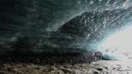 MS TU Shot of melted glacier stream and fallen glaciers inside of glacier cave / Iceland