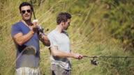 MS PAN Shot of men standing by river fishing / Langley, British Columbia, Canada