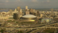 WS AERIAL Shot of mercedes benz superdome and downtown skyline / New Orleans, Louisiana, United States