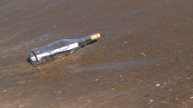 CU Shot of message in bottle / Marbella, Andalusia, Spain