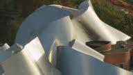 MS TU TD AERIAL Shot of metal roof top of Peter B Lewis Building in University Circle neighborhood / Cleveland, Ohio, United States