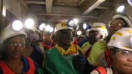 MS ZI Shot of Miners working underground / Johannesburg, Gauteng, South Africa