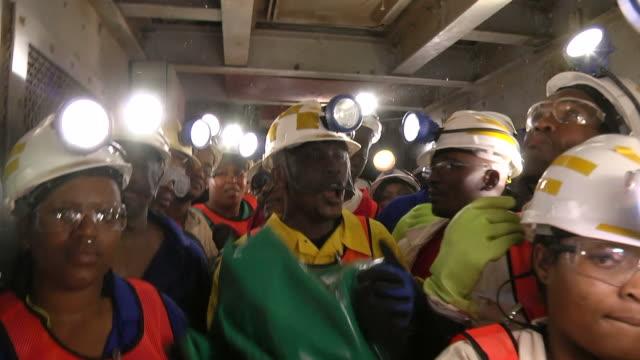 MS ZI Shot of Miners working underground / Johannesburg, Gauteng, South Africa