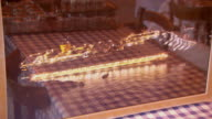 CU Shot of model of Costa Concordia cruise ship sits on restaurant table / Giglio Porto, Tuscany, Italy