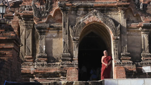 MS Shot of Monk coming out of Dhammayazika temple / Bagan, Mandalay Division, Myanmar