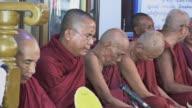 MS Shot of monks sitting together and praying / Bagan, Mandalay Division, Myanmar