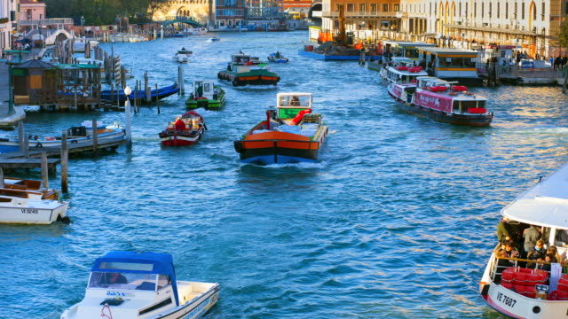 MS T/L Shot of Morning traffic on Canal Grande at St Lucia train station / Venice Veneto Italy